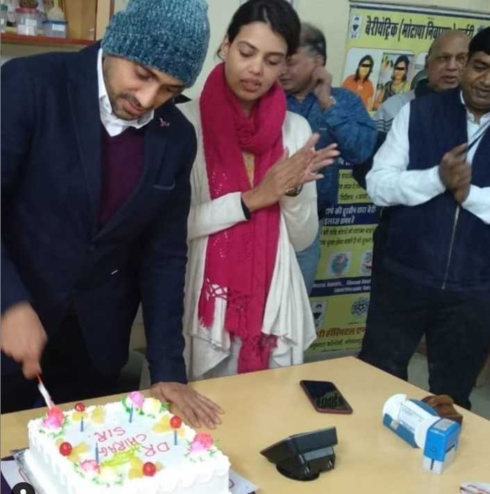 Dr. Chirag Bhandari celebrating his birthday with his wife and colleagues on 31st December